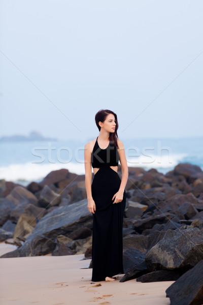 Młodych kobieta czarna sukienka ocean plaży Zdjęcia stock © Massonforstock