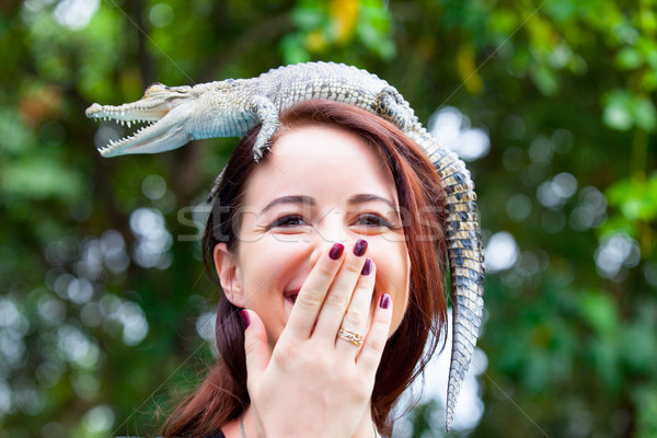 Young woman with crocodile Stock photo © Massonforstock