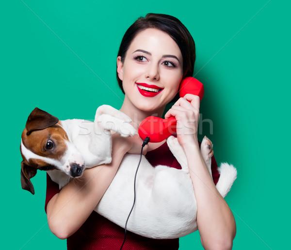 Nő piros telefonkagyló kutya portré fiatal nő Stock fotó © Massonforstock
