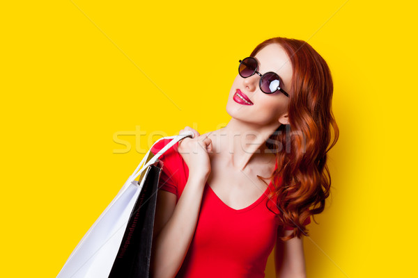 beautiful young woman with shopping bags  on the wonderful yello Stock photo © Massonforstock