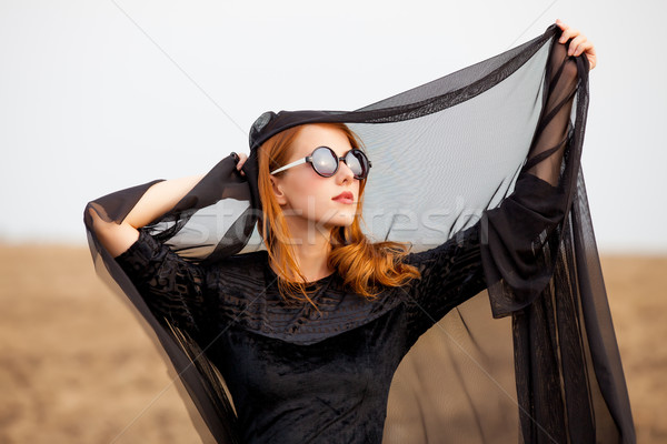 photo of beautiful young woman holding shawl on the wonderful fi Stock photo © Massonforstock