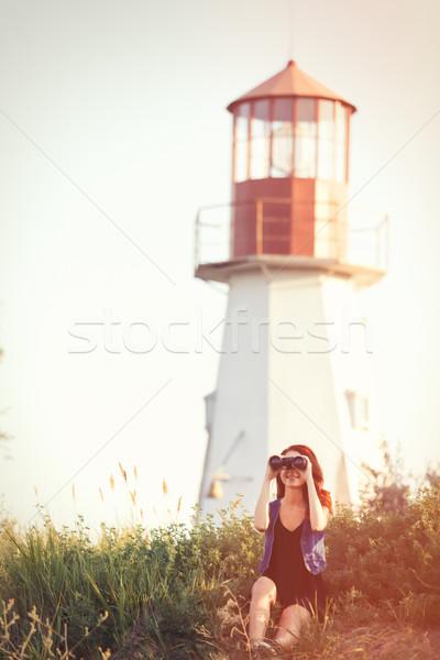 Dziewczyna posiedzenia trawy latarni młodych Zdjęcia stock © Massonforstock