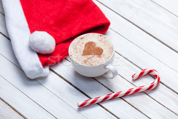 Cup of coffee and Santas hat Stock photo © Massonforstock