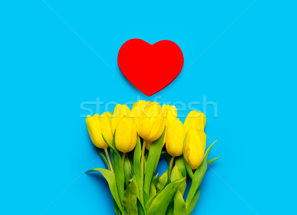 bunch of yellow tulips and beautiful heart shaped toy on the won Stock photo © Massonforstock
