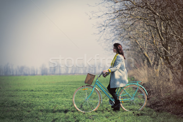beautiful young woman sitting on the bicycle on the wonderful gr Stock photo © Massonforstock