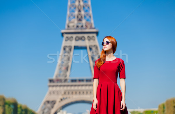 Belle jeune femme Tour Eiffel Paris France beauté Photo stock © Massonforstock