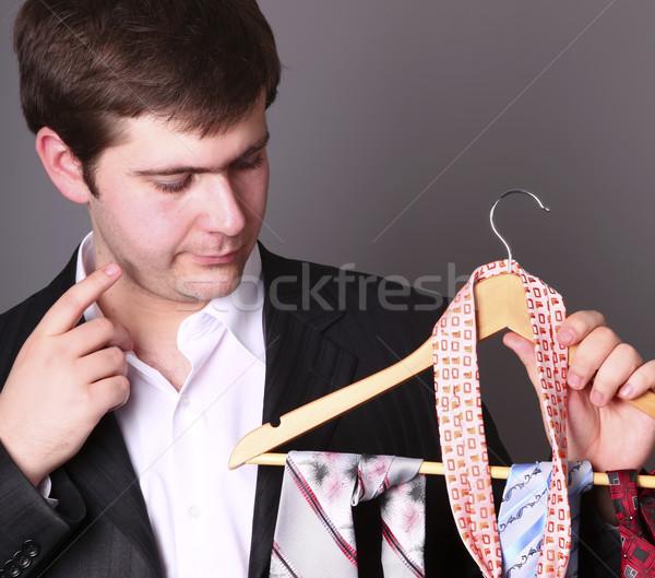 üzletember kiválasztott nyakkendő kéz férfi munka Stock fotó © Massonforstock