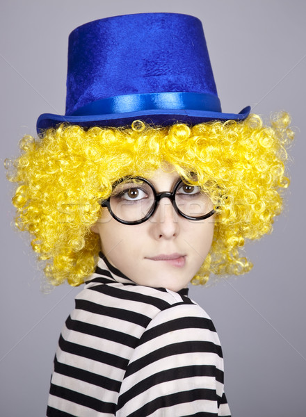 Yellow-haired girl in blue cap and striped knitted jacket.  Stock photo © Massonforstock