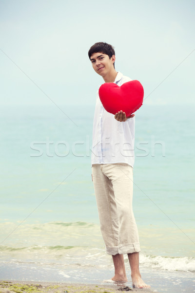Men with toy heart at hte beach. Stock photo © Massonforstock