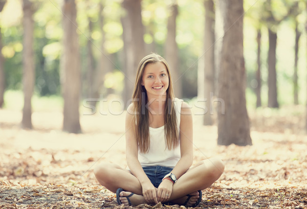 Smiling happy girl in autumn park Stock photo © Massonforstock