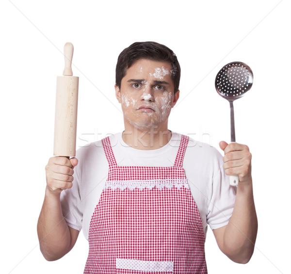 Cooking man with kitchenware  over white bakcground Stock photo © Massonforstock
