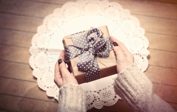 hands holding gift Stock photo © Massonforstock