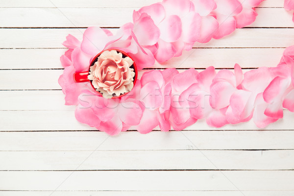 beautiful hawaiian lei and rose in red cup on the wonderful whit Stock photo © Massonforstock