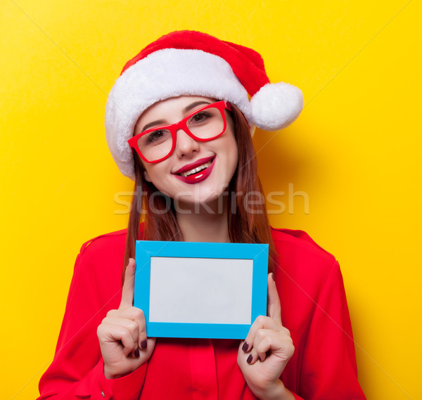 woman with photo frame Stock photo © Massonforstock