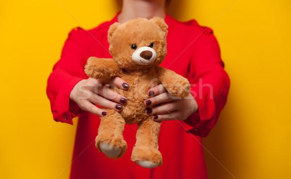Kadın oyuncak ayı oyuncak sarı sevmek Stok fotoğraf © Massonforstock