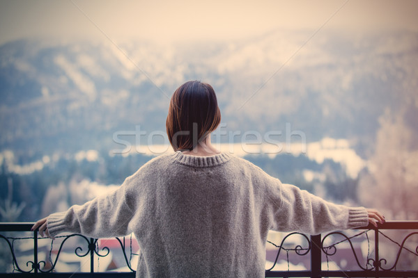 Portrait of a young redhead woman with mountains on background Stock photo © Massonforstock