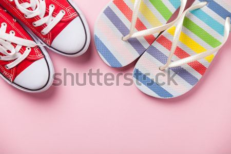 colorful sandals and cute small gift on the wonderful blue backg Stock photo © Massonforstock