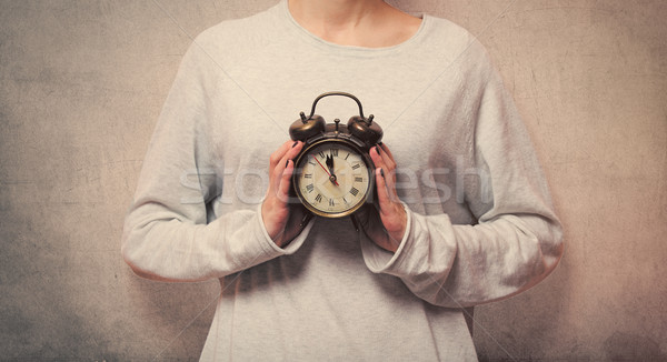 beautiful young woman hands holding a vintage alarm clock on the Stock photo © Massonforstock