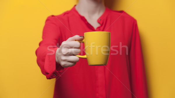 Hermosa mano amarillo taza Foto stock © Massonforstock