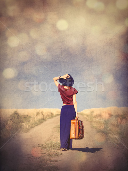 beautiful young woman with suitcase standing in the middle of th Stock photo © Massonforstock