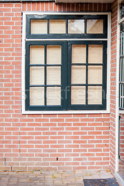 photo of beautiful cool windows with jalousie on one of building Stock photo © Massonforstock