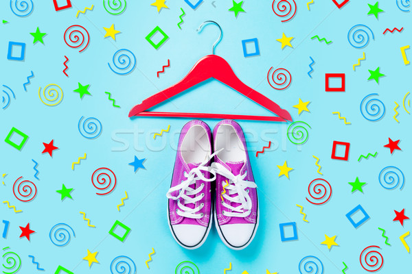 hanger and purple gumshoes on the wonderful blue background in a Stock photo © Massonforstock
