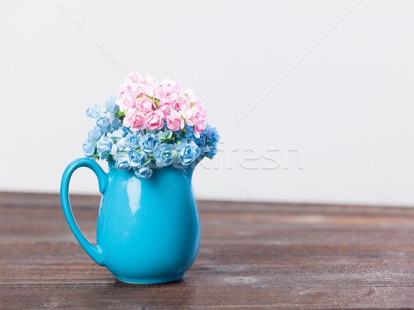 photo of cute bunch of flowers in vase on the wonderful white ba Stock photo © Massonforstock