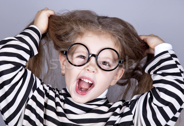 Young shouting child in glasses and striped knitted jacket. Stock photo © Massonforstock