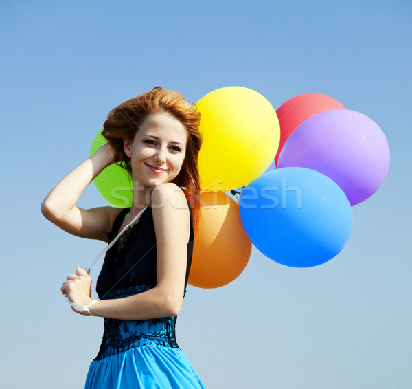 Fille couleur ballons ciel bleu fête Photo stock © Massonforstock
