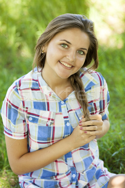 Beautiful teen girl in the park at green grass. Stock photo © Massonforstock
