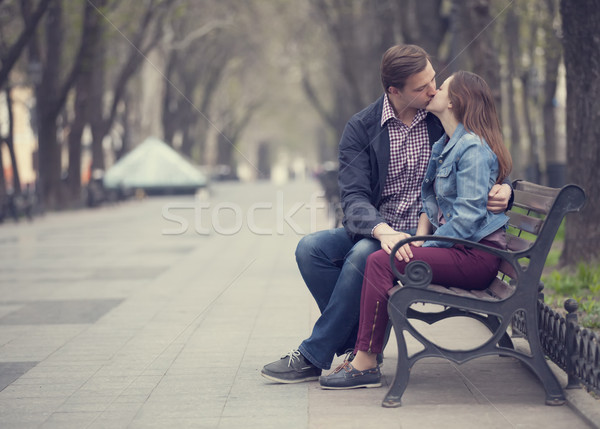 Couple kissing at the bench at alley. Stock photo © Massonforstock