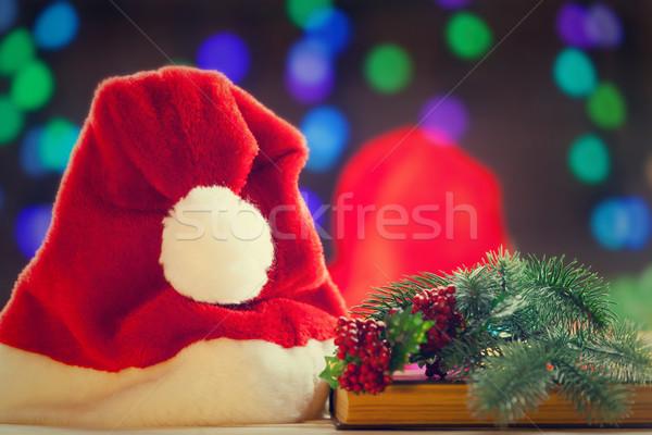 Santas hat and books Stock photo © Massonforstock