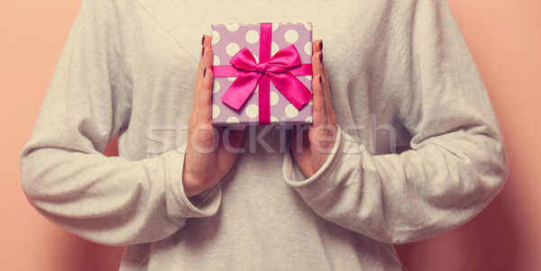 Woman holding a present box Stock photo © Massonforstock