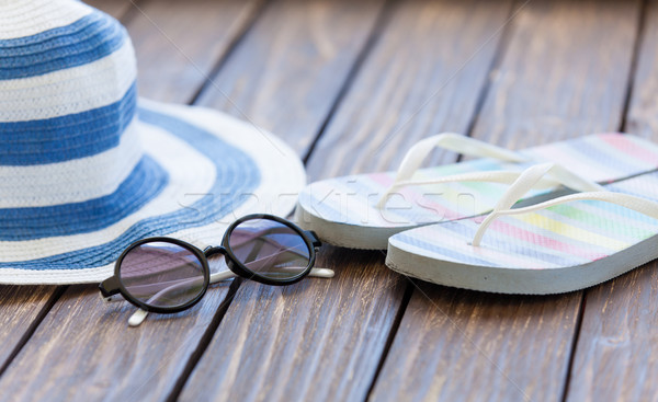 Sunglasses and hat with flip flops  Stock photo © Massonforstock