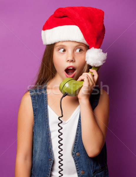 girl in red Santas hat with green handset  Stock photo © Massonforstock
