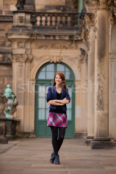 beautiful young woman standing in front of old building Stock photo © Massonforstock
