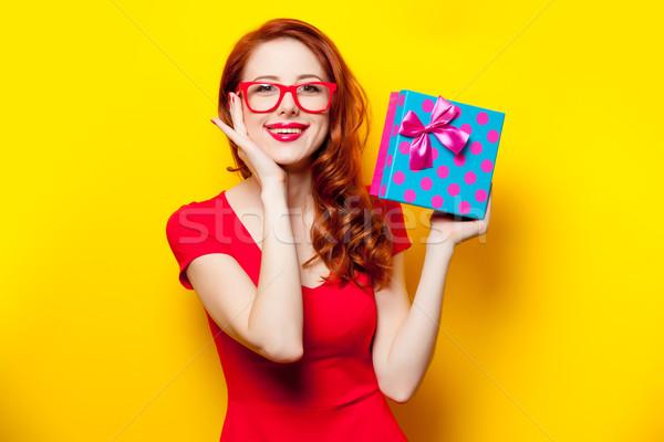 photo of beautiful young woman holding cute gift on the wonderfu Stock photo © Massonforstock