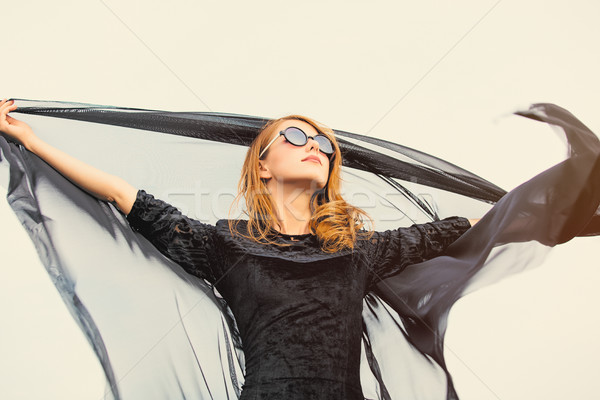photo of beautiful young woman holding shawl on the wonderful  s Stock photo © Massonforstock
