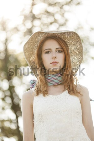 Redhead girl with hat near tree. Stock photo © Massonforstock