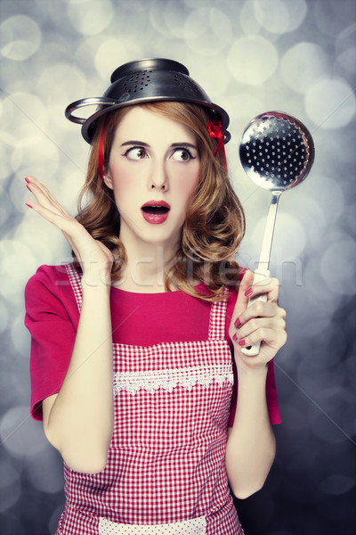 Redhead housewife with soup ladle Stock photo © Massonforstock