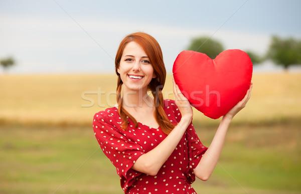 Vörös hajú nő lány játék szív legelő búzamező Stock fotó © Massonforstock