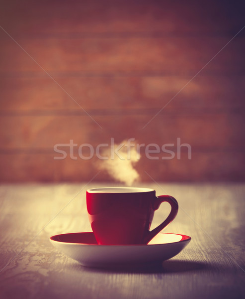 Hot Cup of coffee on wooden background.  Stock photo © Massonforstock