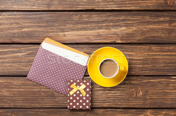 Cup of coffee and envelope with gift boxes  Stock photo © Massonforstock