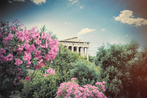 photo of old temple surrounded with trees and blooming flowers i Stock photo © Massonforstock