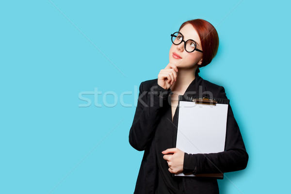beautiful young woman with clipboard on the wonderful blue backg Stock photo © Massonforstock