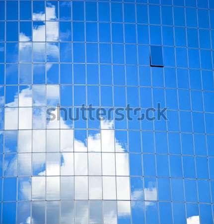 High-rise edifício de vidro céu nuvens reflexão edifício Foto stock © Massonforstock