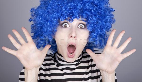 Surprised blue hair girl Stock photo © Massonforstock