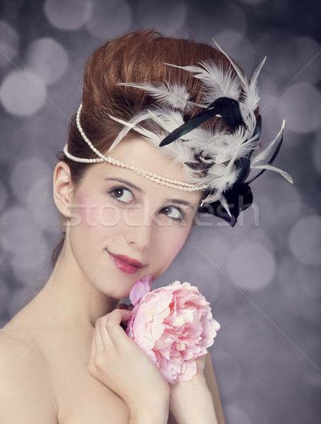 Redhead girl with Rococo hair style and flower at vintage backgr Stock photo © Massonforstock