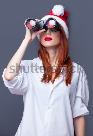 Funny redhead girl in hat with camera and bokeh at background Stock photo © Massonforstock