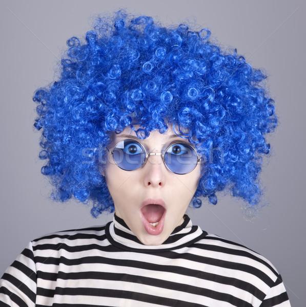 Surprised blue hair girl. Stock photo © Massonforstock